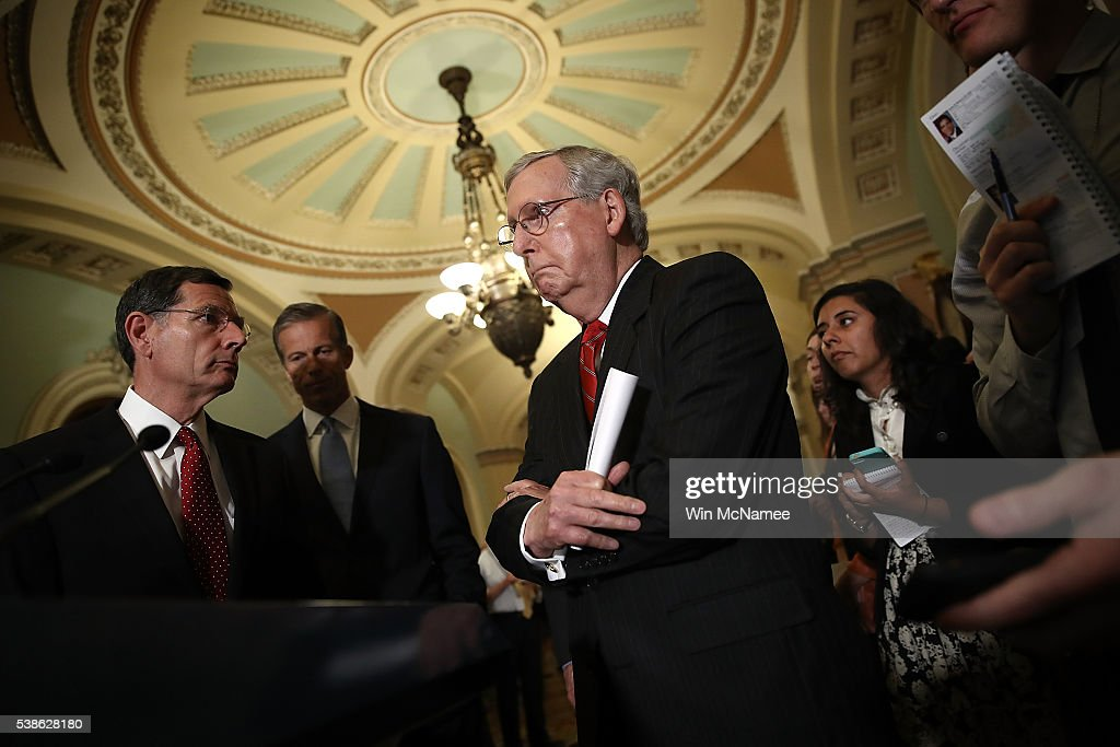 Senate Majority Leader <a gi-track='captionPersonalityLinkClicked' href=/galleries/search?phrase=Mitch+McConnell&family=editorial&specificpeople=217985 ng-click='$event.stopPropagation()'>Mitch McConnell</a> (R-KY) answers questions about recent comments made by Republican presidential candidate Donald Trump June 7, 2016 in Washington, DC. Republican leaders faced intense questioning from members of the media regarding Trump's comments following their weekly party luncheon. Also pictured L-R are Sen. <a gi-track='captionPersonalityLinkClicked' href=/galleries/search?phrase=John+Barrasso&family=editorial&specificpeople=5312607 ng-click='$event.stopPropagation()'>John Barrasso</a> (R-WY) and Sen. <a gi-track='captionPersonalityLinkClicked' href=/galleries/search?phrase=John+Thune&family=editorial&specificpeople=534356 ng-click='$event.stopPropagation()'>John Thune</a> (R-SD).