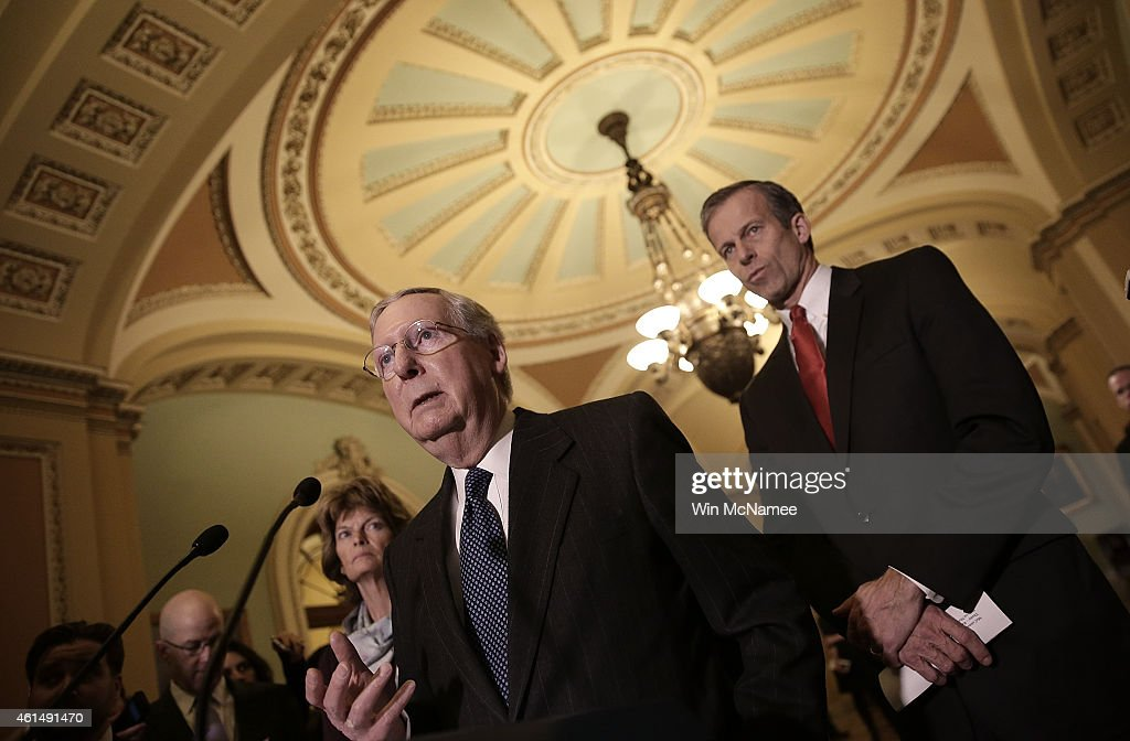 Senate Majority Leader <a gi-track='captionPersonalityLinkClicked' href=/galleries/search?phrase=Mitch+McConnell&family=editorial&specificpeople=217985 ng-click='$event.stopPropagation()'>Mitch McConnell</a> (C) (R-KY) answers questions following a weekly policy luncheon with Senate Republicans at the U.S. Capitol January 13, 2015 in Washington, DC. McConnell discussed a meeting he attended with U.S. President Barack Obama earlier in the day at the White Hous. Also pictured are Sen. <a gi-track='captionPersonalityLinkClicked' href=/galleries/search?phrase=John+Thune&family=editorial&specificpeople=534356 ng-click='$event.stopPropagation()'>John Thune</a> (R) (R-SD) and Sen. <a gi-track='captionPersonalityLinkClicked' href=/galleries/search?phrase=Lisa+Murkowski&family=editorial&specificpeople=3134392 ng-click='$event.stopPropagation()'>Lisa Murkowski</a> (L) (R-AK).