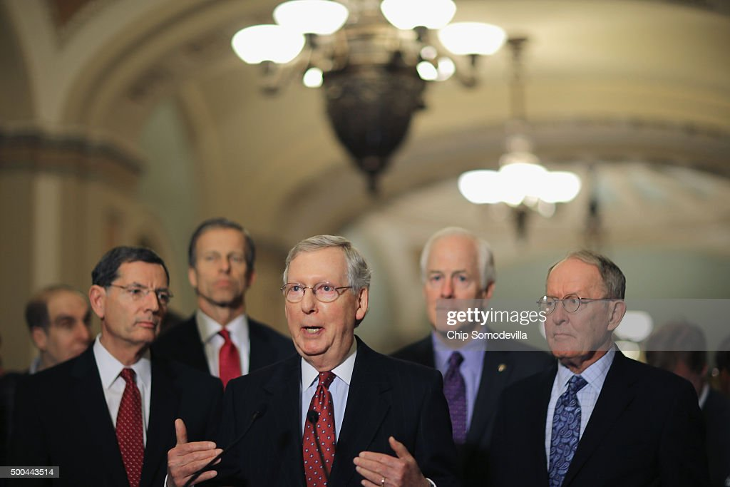 Senate Majority Leader Mitch McConnell answers reporters' questions during a news briefing with Sen John Barrasso Sen John Thune Sen John Cornyn and...