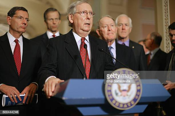 Senate Majority Leader Mitch McConnell answers reporters' questions during a news briefing with Sen John Barrasso Sen John Thune Sen Lamar Alexander...