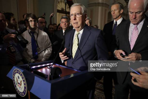 S Senate Majority Leader Mitch McConnell approaches the microphones before talking with reporters with Sen Cory Gardner Sen John Thune and Senate...