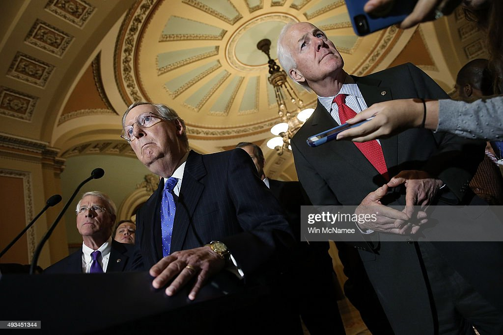 Senate Majority Leader <a gi-track='captionPersonalityLinkClicked' href=/galleries/search?phrase=Mitch+McConnell&family=editorial&specificpeople=217985 ng-click='$event.stopPropagation()'>Mitch McConnell</a> (C) (R-KY) arrives to answer questions after a weekly policy meeting at the U.S. Capitol as Sen. <a gi-track='captionPersonalityLinkClicked' href=/galleries/search?phrase=Roger+Wicker&family=editorial&specificpeople=1194753 ng-click='$event.stopPropagation()'>Roger Wicker</a> (R-MS) (L) and Sen. <a gi-track='captionPersonalityLinkClicked' href=/galleries/search?phrase=John+Cornyn&family=editorial&specificpeople=154884 ng-click='$event.stopPropagation()'>John Cornyn</a> (R-TX) looks on October 20, 2015 in Washington, DC. McConnell answered a range of questions on the pending Senate voting schedule during his remarks.