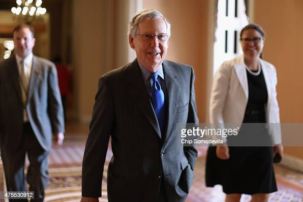 Senate Majority Leader Mitch McConnell heads to the Senate Chamber at the US Capitol June 1 2015 in Washington DC In protest of the National Security...