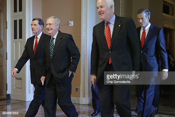 Senate Majority Leader Mitch McConnell leaves his office with Sen John Barrasso Senate Majority Whip John Cornyn and Sen John Thune following the...