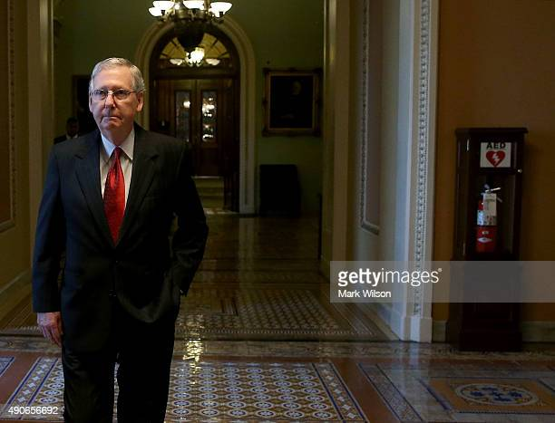 Senate Majority Leader Mitch McConnell leaves the Senate Chamber after a vote to avert a government shutdown on Capitol Hill September 30 2015 in...