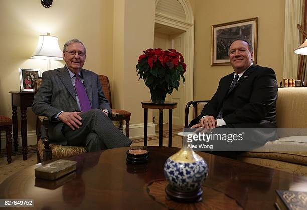 S Senate Majority Leader Mitch McConnell meets in his office with Rep Mike Pompeo December 5 2016 at the Capitol in Washington DC Presidentelect...