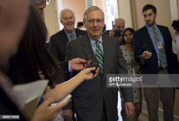 US Senate Majority Leader Mitch McConnell Republican of Kentucky walks through the US Capitol in Washington DC June 22 following the release of a...