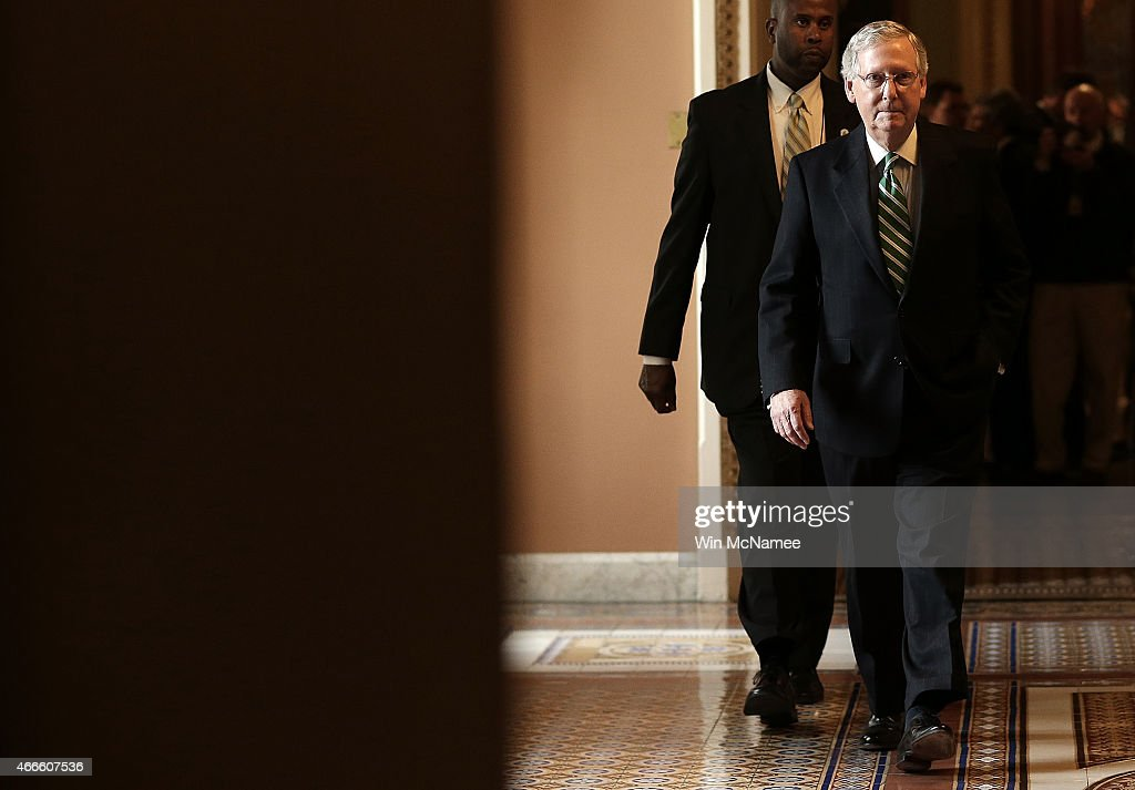 Senate Majority Leader <a gi-track='captionPersonalityLinkClicked' href=/galleries/search?phrase=Mitch+McConnell&family=editorial&specificpeople=217985 ng-click='$event.stopPropagation()'>Mitch McConnell</a> (R-KY) returns to his office following a press conference at the U.S. Capitol March 17, 2015 in Washington, DC. McConnell answered questions on the stalled Senate vote on Attorney General nominee Loretta Lynch during the press conference that followed the weekly Republican policy luncheon.