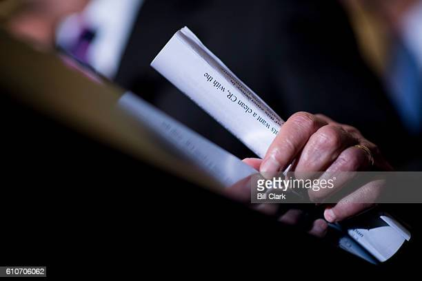 Senate Majority Leader Mitch McConnell RKy holds a copy of his opening remarks as he speaks to the press about the continuing resolution in the Ohio...