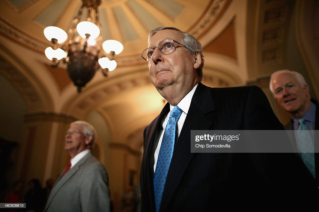 Senate Majority Leader <a gi-track='captionPersonalityLinkClicked' href=/galleries/search?phrase=Mitch+McConnell&family=editorial&specificpeople=217985 ng-click='$event.stopPropagation()'>Mitch McConnell</a> (R-KY) (C), Sen. <a gi-track='captionPersonalityLinkClicked' href=/galleries/search?phrase=Roger+Wicker&family=editorial&specificpeople=1194753 ng-click='$event.stopPropagation()'>Roger Wicker</a> (R-MS) (L) and Sen. <a gi-track='captionPersonalityLinkClicked' href=/galleries/search?phrase=John+Cornyn&family=editorial&specificpeople=154884 ng-click='$event.stopPropagation()'>John Cornyn</a> (R-TX) prepare to speak to reporters after the weekly Senate Republican policy luncheon at the U.S. Capitol August 4, 2015 in Washington, DC. McConnell and his leadership team said they will work to pass a cybersecurity bill before the end of the week when the Senate will break for four weeks.