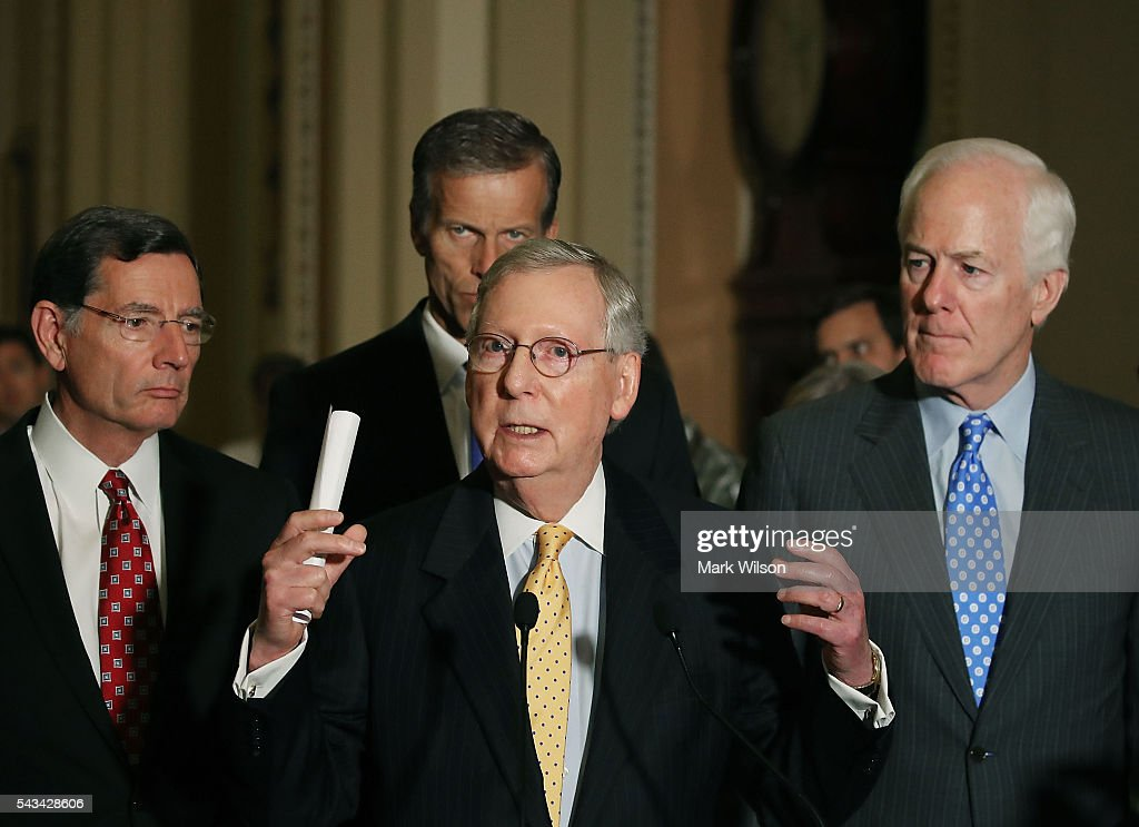 Senate Majority Leader Mitch McConnell (R-KY), (C), speaks to reporters on Capitol Hill, June 28, 2016 in Washington, DC. Also pictured are (L-R), Sen. John Barrasso (R-WY), Sen. John Thune (R-SD), and Sen. John Cornyn (R-TX). The Senate lawmakers addressed the press affter their weekly policy luncheons.