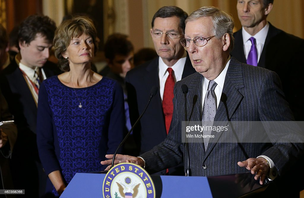 Senate Majority Leader Mitch McConnell speaks to reporters outside the Senate chamber following a luncheon for Republican members of the Senate...