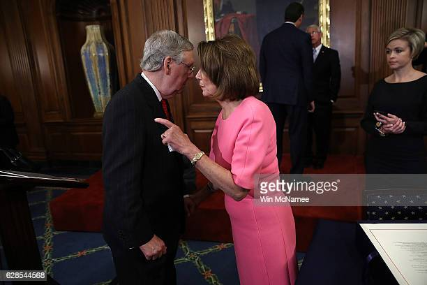 S Senate Majority Leader Mitch McConnell speaks with House Minority Leader Rep Nancy Pelosi following an event marking the passage of the 21st...
