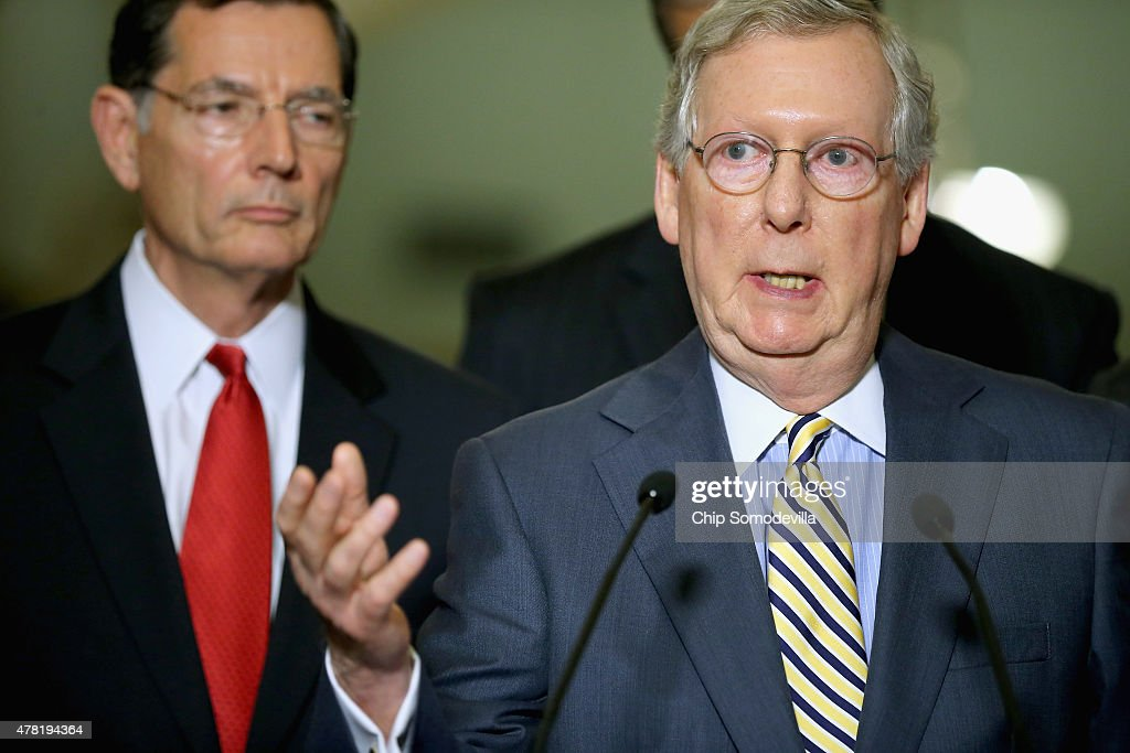 Senate Majority Leader <a gi-track='captionPersonalityLinkClicked' href=/galleries/search?phrase=Mitch+McConnell&family=editorial&specificpeople=217985 ng-click='$event.stopPropagation()'>Mitch McConnell</a> (R-KY) (R) talks to reporters with Sen. <a gi-track='captionPersonalityLinkClicked' href=/galleries/search?phrase=John+Barrasso&family=editorial&specificpeople=5312607 ng-click='$event.stopPropagation()'>John Barrasso</a> (R-WY) after the weekly Republican Senate policy luncheon at the U.S. Capitol June 23, 2015 in Washington, DC. The Senate passed an important procedural vote on the Trans Pacific Partnership bill, which would grant President Barack Obama enhanced negotiating powers to complete a major trade accord, clearing the way for final passage as early as Wednesday.