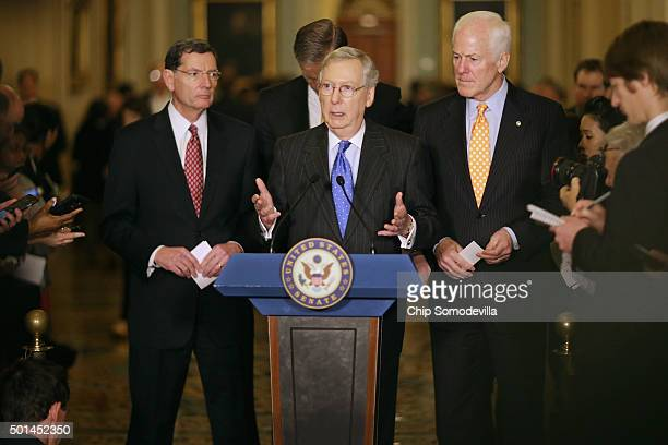 Senate Majority Leader Mitch McConnell talks to reporters with Sen John Barrasso and Senate Majority Whip John Cornyn following the weekly Senate GOP...