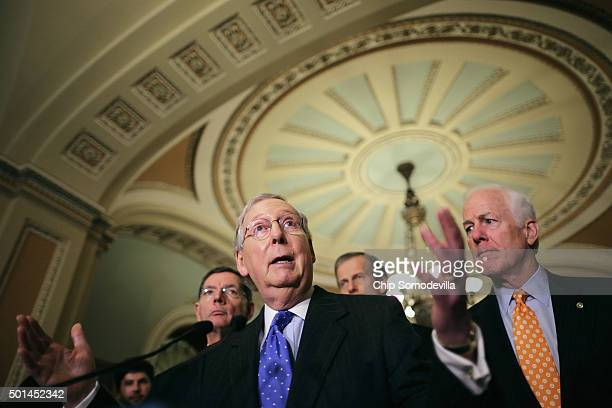 Senate Majority Leader Mitch McConnell talks to reporters with Senate Majority Whip John Cornyn following the weekly Senate GOP policy luncheon at...