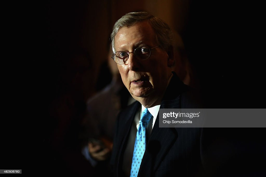 Senate Majority Leader Mitch McConnell (R-KY) talks with reporters reporters after the weekly Senate Republican policy luncheon at the U.S. Capitol August 4, 2015 in Washington, DC. McConnell and his leadership team said they will work to pass a cybersecurity bill before the end of the week when the Senate will break for four weeks.