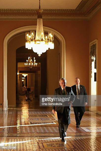 Senate Majority Leader Mitch McConnell walks from his office in the US Capitol to the Senate chamber to open debate on a funding bill for the...