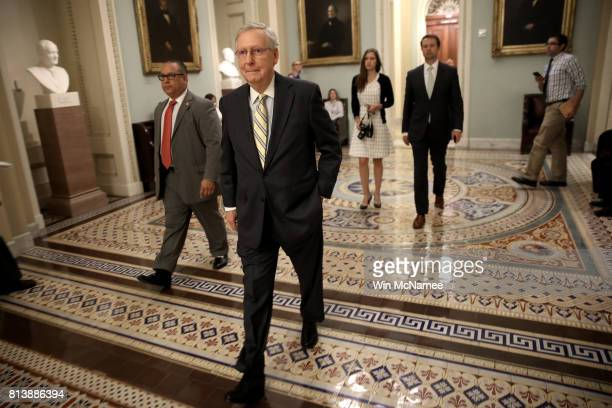 Senate Majority Leader Mitch McConnell walks to a meeting of Republican senators where a new version of their healthcare bill was scheduled to be...