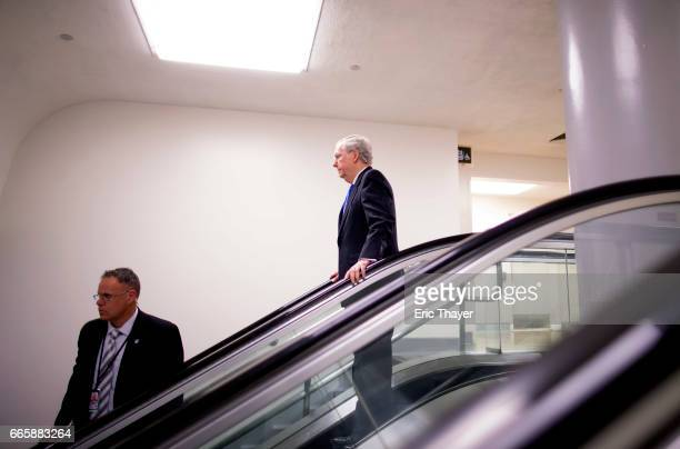 Senate Majority Leader Mitch McConnell walks to a military briefing for US senators on the recent US attack in Syria April 7 2017 in Washington DC US...