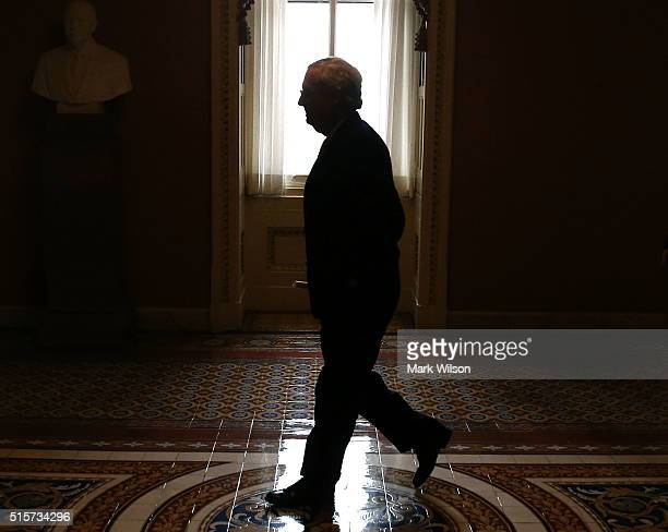 Senate Majority Leader Mitch McConnell walks to his office after speaking to the media after attending the Senate Republican's weekly policy meeting...