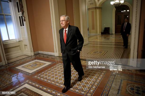 S Senate Majority Leader Mitch McConnell walks to his office in the Capitol September 26 2017 in Washington DC The US Senate is expected to reach a...