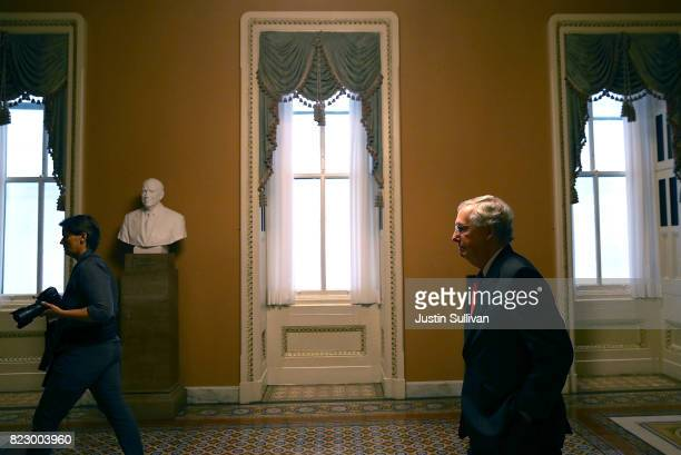 Senate Majority Leader Mitch McConnell walks to his office on July 26 2017 in Washington DC The US Senate will continue debate on the Better Care...