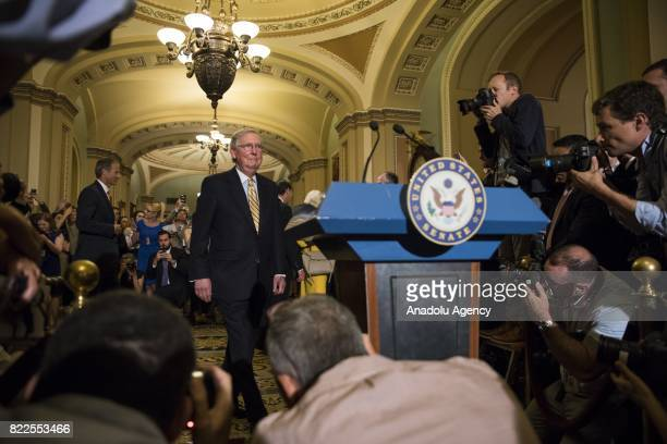 Senate Majority Leader Mitch McConnell walks up to the podium after the Senate narrowly passed the Procedural Vote for the replacement of the...
