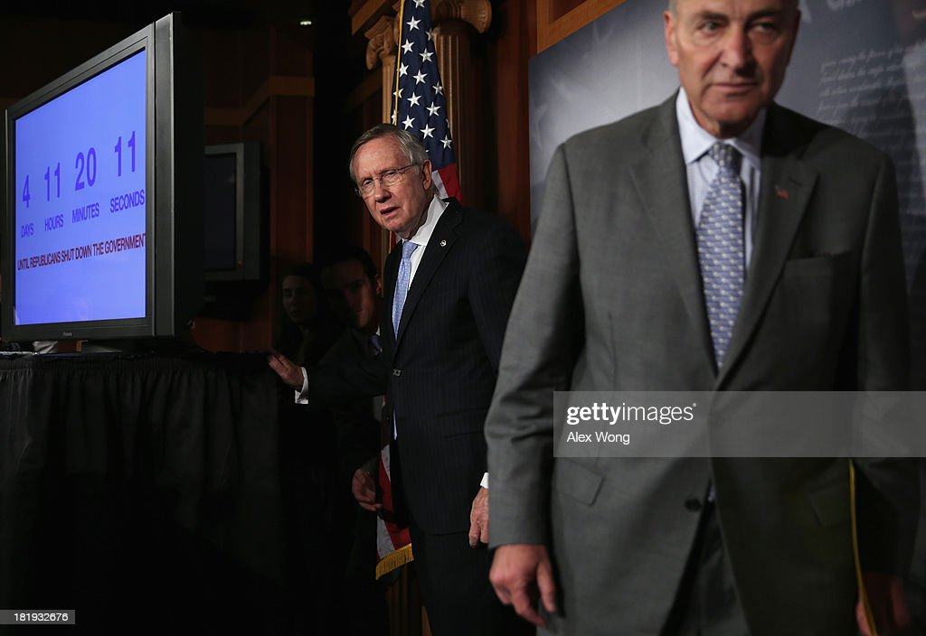 U.S. Senate Majority Leader Sen. <a gi-track='captionPersonalityLinkClicked' href=/galleries/search?phrase=Harry+Reid+-+Politician&family=editorial&specificpeople=203136 ng-click='$event.stopPropagation()'>Harry Reid</a> (D-NV) (L) and Sen. <a gi-track='captionPersonalityLinkClicked' href=/galleries/search?phrase=Charles+Schumer&family=editorial&specificpeople=171249 ng-click='$event.stopPropagation()'>Charles Schumer</a> (D-NY) (R) leave after a news conference September 26, 2013 on Capitol Hill in Washington, DC. The Democratic senators held a news conference to call on the House Republicans not to shutdown the government.