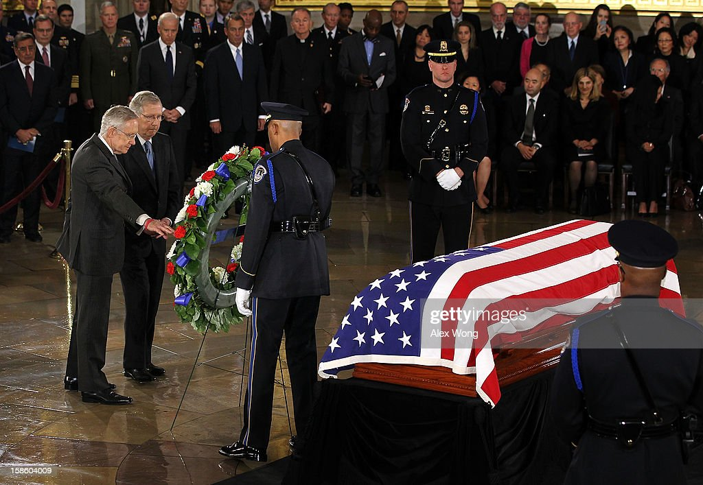 U.S. Senate Majority Leader Sen. Harry Reid (D-NV) (L) and Senate Minority Leader Sen. Mitch McConnell (R-KY) (2nd L) place a wreath in front of the flag draped casket as Senator Daniel Inouye (D-HI) lies in state in the Rotunda of the U.S. Capitol during a service December 20, 2012 on Capitol Hill in Washington, DC. The late Senator had died at the age of 88 on Monday at the Walter Reed National Military Medical Center in Bethesda, Maryland where he had been hospitalized since early December. A public funeral service will be held at the Washington National Cathedral on Friday for Senator Inouye, a World War II veteran and the second-longest serving senator in history. His remains will be returned and laid to rest in his home state.