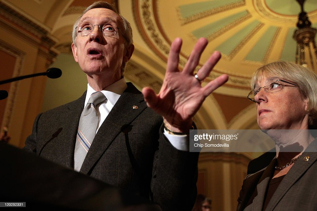 Senate Majority Leader Sen. <a gi-track='captionPersonalityLinkClicked' href=/galleries/search?phrase=Harry+Reid+-+Pol%C3%ADtico&family=editorial&specificpeople=203136 ng-click='$event.stopPropagation()'>Harry Reid</a> (D-NV) (L) answers reporters' questions during a news conference with Sen. <a gi-track='captionPersonalityLinkClicked' href=/galleries/search?phrase=Patty+Murray&family=editorial&specificpeople=532963 ng-click='$event.stopPropagation()'>Patty Murray</a> (D-WA) at the U.S. Capitol August 2, 2011 in Washington, DC. The Senate voted 74-26 to pass the bipartisan debt ceiling legislation that reduces the deficit by $2.4 trillion over the next 10 years. The bill now goes to the White House where President Barack Obama is expected to sign it.