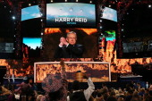 S Senate Majority Leader Sen Harry Reid gestures at the podium during day one of the Democratic National Convention at Time Warner Cable Arena on...