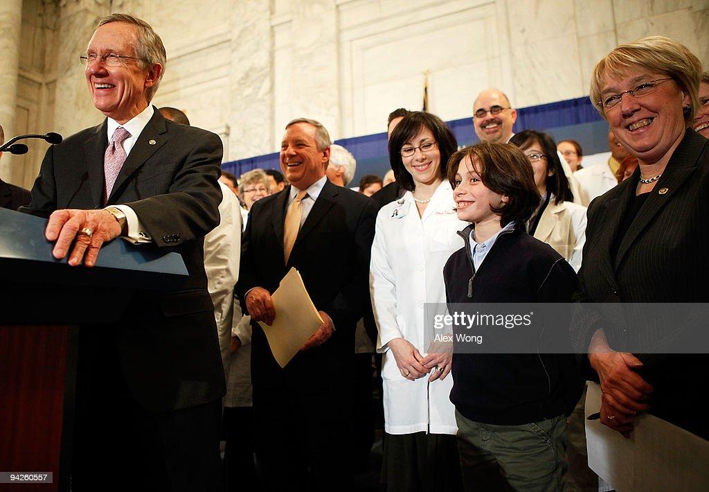 S Senate Majority Leader Sen Harry Reid laughs with Senate Majority Whip Sen Richard Durbin Sen Patty Murray and an independent group of doctors...