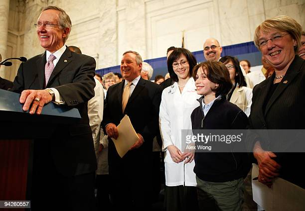 S Senate Majority Leader Sen Harry Reid laughs with Senate Majority Whip Sen Richard Durbin Sen Patty Murray and an independent group of doctors...