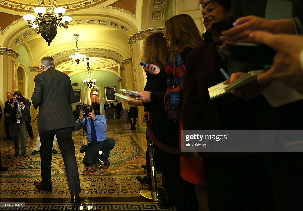 U.S. Senate Majority Leader Sen. Harry Reid (D-NV) leaves after he spoke to members of the media during a news briefing after the weekly Senate Democratic Policy Luncheon December 11, 2012 on Capitol Hill in Washington, DC. Reid discussed various topics with the media including the 'fiscal cliff' issue.
