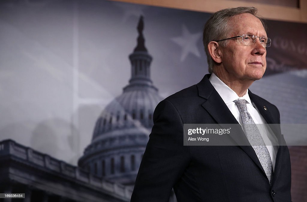 U.S. Senate Majority Leader Sen. <a gi-track='captionPersonalityLinkClicked' href=/galleries/search?phrase=Harry+Reid+-+Politician&family=editorial&specificpeople=203136 ng-click='$event.stopPropagation()'>Harry Reid</a> (D-NV) listens during a news conference May 23, 2013 on Capitol Hill in Washington, DC. The Senate Democratic leadership held a news conference to highlight the continued obstruction by Senate Republicans of President Obama's executive and judicial nominees.