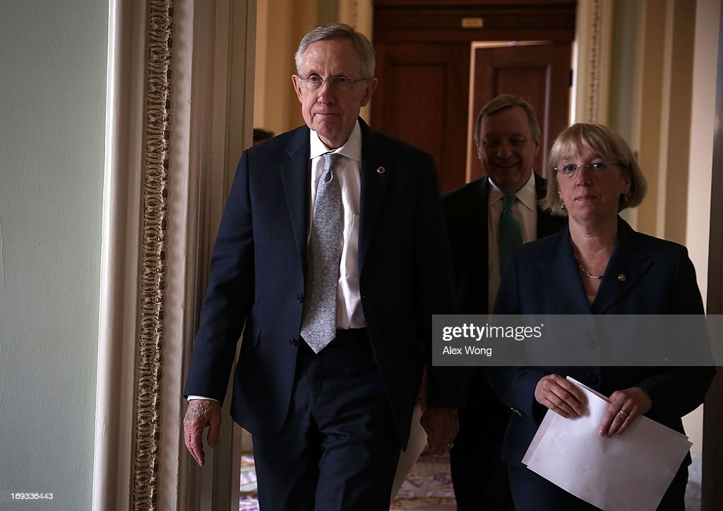 U.S. Senate Majority Leader Sen. <a gi-track='captionPersonalityLinkClicked' href=/galleries/search?phrase=Harry+Reid+-+Politician&family=editorial&specificpeople=203136 ng-click='$event.stopPropagation()'>Harry Reid</a> (D-NV) (L), Senate Majority Whip U.S. Sen. Richard Durbin (D-IL) (2nd L) and U.S. Sen. <a gi-track='captionPersonalityLinkClicked' href=/galleries/search?phrase=Patty+Murray&family=editorial&specificpeople=532963 ng-click='$event.stopPropagation()'>Patty Murray</a> (D-WA) (R) while they are on their to attend a news conference May 23, 2013 on Capitol Hill in Washington, DC. The Senate Democratic leadership held a news conference to highlight the continued obstruction by Senate Republicans of President Obama's executive and judicial nominees.