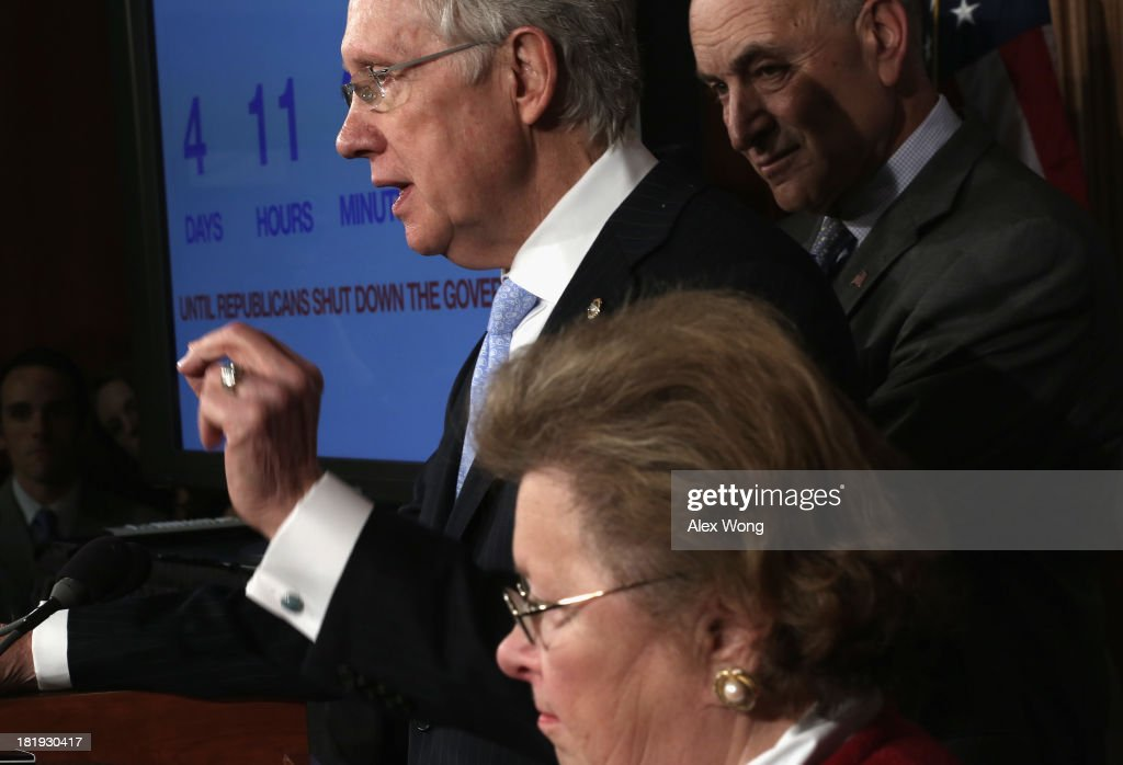 U.S. Senate Majority Leader Sen. <a gi-track='captionPersonalityLinkClicked' href=/galleries/search?phrase=Harry+Reid+-+Politician&family=editorial&specificpeople=203136 ng-click='$event.stopPropagation()'>Harry Reid</a> (D-NV) (L) speaks as Sen. <a gi-track='captionPersonalityLinkClicked' href=/galleries/search?phrase=Charles+Schumer&family=editorial&specificpeople=171249 ng-click='$event.stopPropagation()'>Charles Schumer</a> (D-NY) (R), and Sen. <a gi-track='captionPersonalityLinkClicked' href=/galleries/search?phrase=Barbara+Mikulski&family=editorial&specificpeople=226768 ng-click='$event.stopPropagation()'>Barbara Mikulski</a> (D-MD) (2nd L) listen during a news conference September 26, 2013 on Capitol Hill in Washington, DC. The Democratic senators held a news conference to call on the House Republicans not to shutdown the government.
