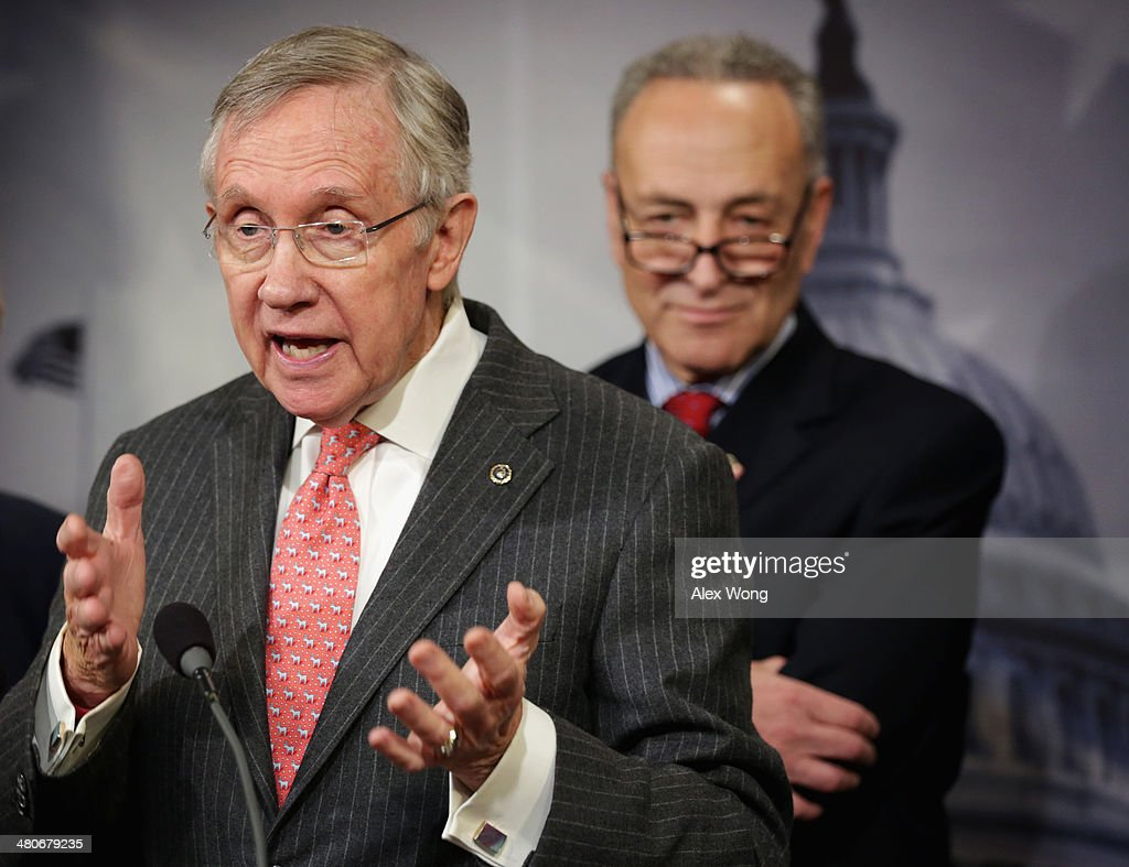 U.S. Senate Majority Leader Sen. <a gi-track='captionPersonalityLinkClicked' href=/galleries/search?phrase=Harry+Reid&family=editorial&specificpeople=203136 ng-click='$event.stopPropagation()'>Harry Reid</a> (D-NV) (L) speaks as Sen. <a gi-track='captionPersonalityLinkClicked' href=/galleries/search?phrase=Charles+Schumer&family=editorial&specificpeople=171249 ng-click='$event.stopPropagation()'>Charles Schumer</a> (D-NY) (R) listens during a news conference March 26, 2014 on Capitol Hill in Washington, DC. Senate Democrats held a news conference to unveil 2014 agenda: 'A Fair Shot for Everyone,' including topics on minimum wage, equal pay for women, Medicare for seniors, job creation and small business development.