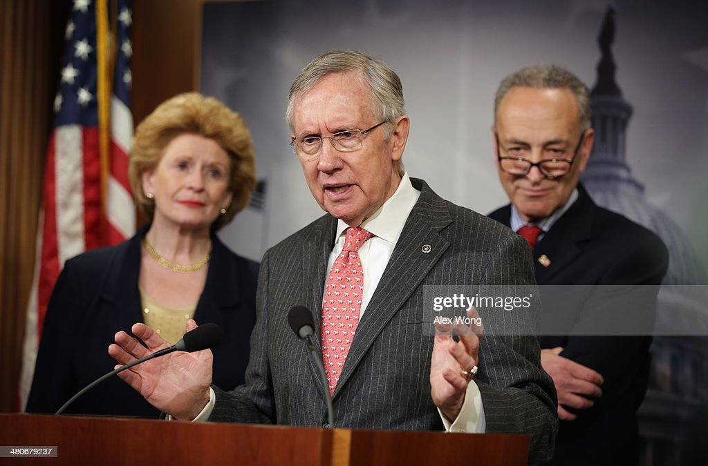 S Senate Majority Leader Sen Harry Reid speaks as Sen Debbie Stabenow and Sen Charles Schumer listen during a news conference March 26 2014 on...