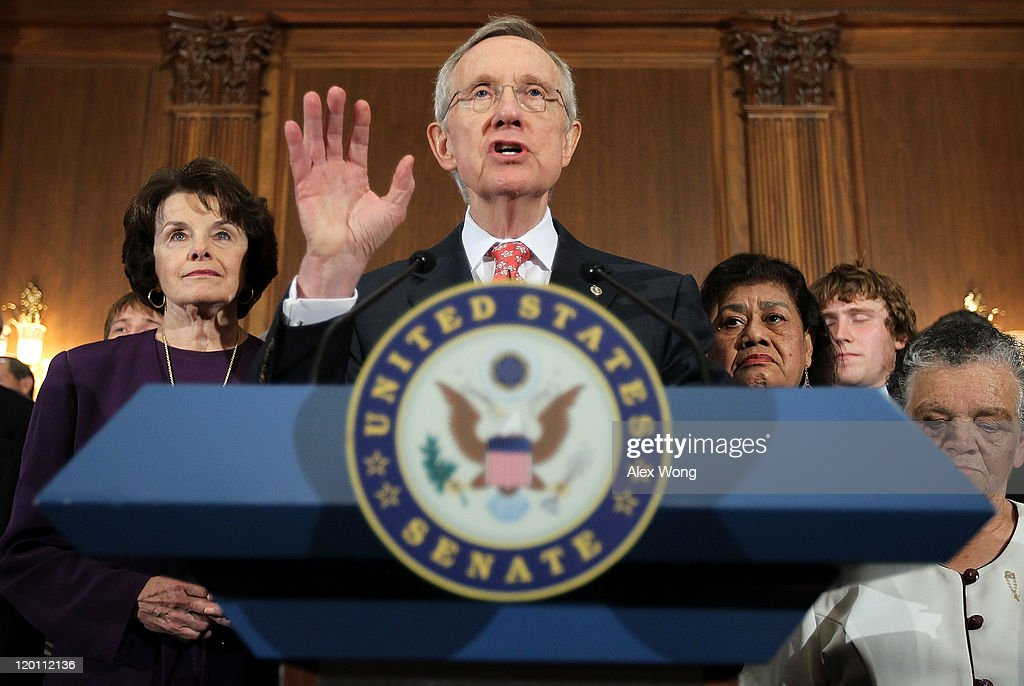 U.S. Senate Majority Leader Sen. <a gi-track='captionPersonalityLinkClicked' href=/galleries/search?phrase=Harry+Reid+-+Politician&family=editorial&specificpeople=203136 ng-click='$event.stopPropagation()'>Harry Reid</a> (D-NV) (2nd L) speaks as Sen. <a gi-track='captionPersonalityLinkClicked' href=/galleries/search?phrase=Dianne+Feinstein&family=editorial&specificpeople=214078 ng-click='$event.stopPropagation()'>Dianne Feinstein</a> (D-CA) (L) listens during a news conference July 30, 2011 on Capitol Hill in Washington, DC. The House rejected Reid's proposed debt ceiling bill one day after the Senate rejected U.S. Speaker of the House Rep. John Boehner's (R-OH) plan.