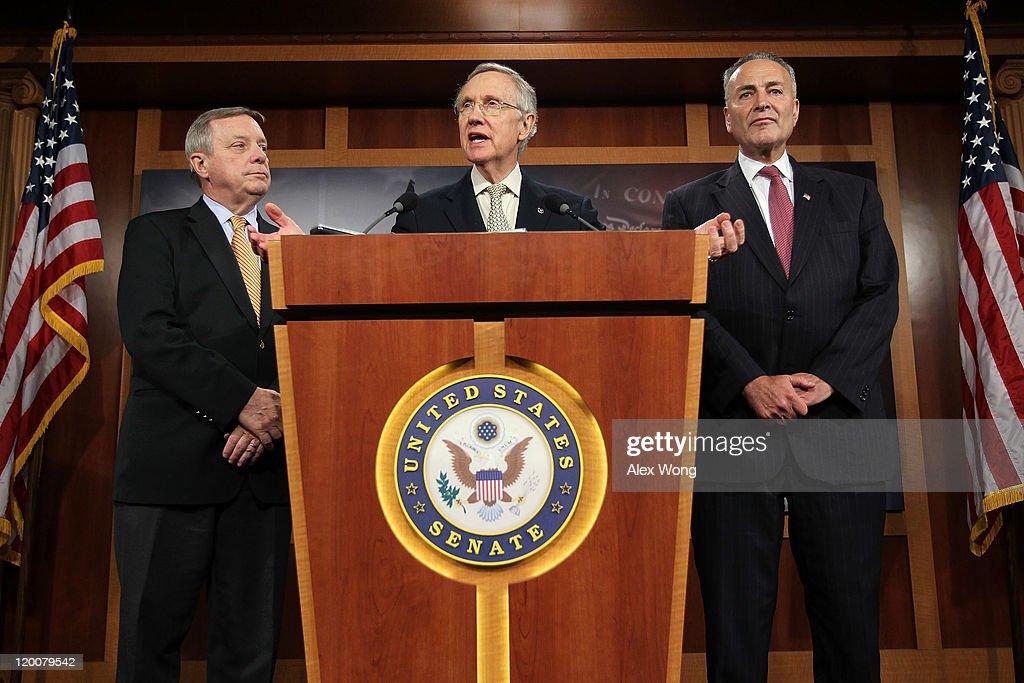 S Senate Majority Leader Sen Harry Reid speaks as Senate Majority Whip Sen Richard Durbin and Sen Charles Schumer listen during a news conference...