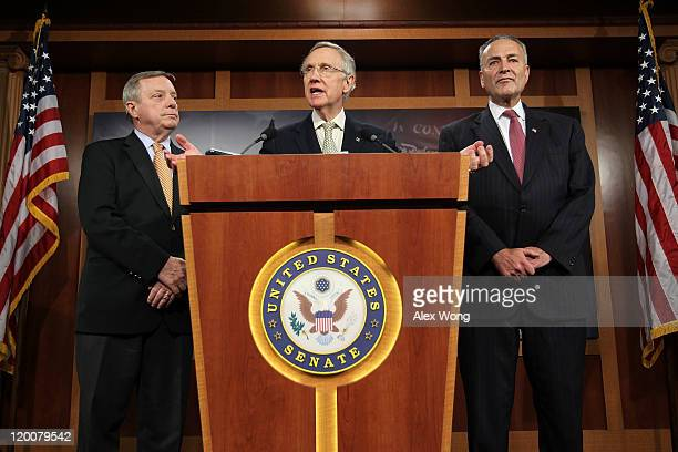 S Senate Majority Leader Sen Harry Reid speaks as Senate Majority Whip Sen Richard Durbin and Sen Charles Schumer listen during a news conference...