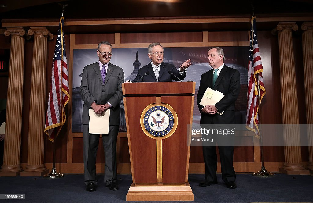 U.S. Senate Majority Leader Sen. <a gi-track='captionPersonalityLinkClicked' href=/galleries/search?phrase=Harry+Reid&family=editorial&specificpeople=203136 ng-click='$event.stopPropagation()'>Harry Reid</a> (D-NV) (2nd L) speaks as Senate Majority Whip U.S. Sen. Richard Durbin (D-IL) (R), and U.S. Sen. <a gi-track='captionPersonalityLinkClicked' href=/galleries/search?phrase=Charles+Schumer&family=editorial&specificpeople=171249 ng-click='$event.stopPropagation()'>Charles Schumer</a> (D-NY) (L) listen during a news conference May 23, 2013 on Capitol Hill in Washington, DC. The Senate Democratic leadership held a news conference to highlight the continued obstruction by Senate Republicans of President Obama's executive and judicial nominees.