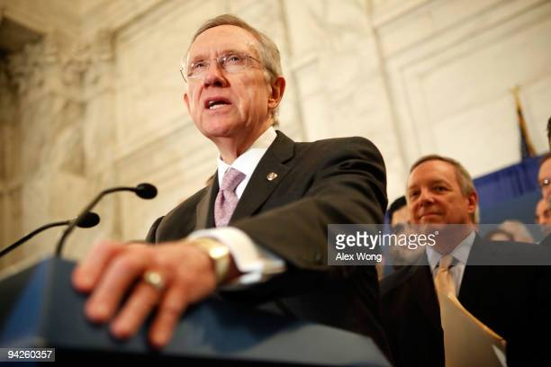 S Senate Majority Leader Sen Harry Reid speaks as Senate Majority Whip Sen Richard Durbin listens during a news conference December 10 2009 on...