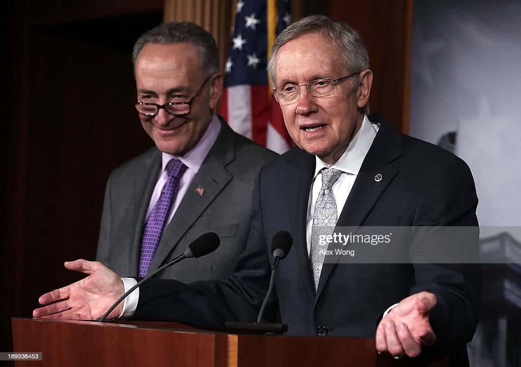 U.S. Senate Majority Leader Sen. <a gi-track='captionPersonalityLinkClicked' href=/galleries/search?phrase=Harry+Reid+-+Politician&family=editorial&specificpeople=203136 ng-click='$event.stopPropagation()'>Harry Reid</a> (D-NV) (R) speaks as U.S. Sen. <a gi-track='captionPersonalityLinkClicked' href=/galleries/search?phrase=Charles+Schumer&family=editorial&specificpeople=171249 ng-click='$event.stopPropagation()'>Charles Schumer</a> (D-NY) (L) listens during a news conference May 23, 2013 on Capitol Hill in Washington, DC. The Senate Democratic leadership held a news conference to highlight the continued obstruction by Senate Republicans of President Obama's executive and judicial nominees.