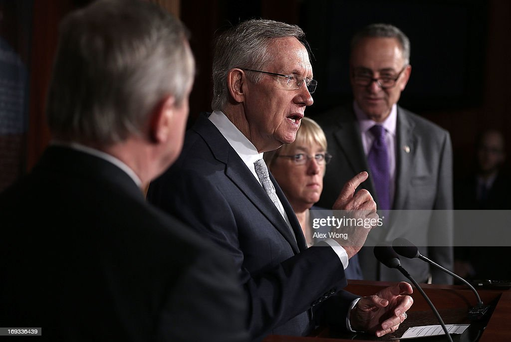 U.S. Senate Majority Leader Sen. <a gi-track='captionPersonalityLinkClicked' href=/galleries/search?phrase=Harry+Reid+-+Politician&family=editorial&specificpeople=203136 ng-click='$event.stopPropagation()'>Harry Reid</a> (D-NV) (L) speaks as U.S. Sen. <a gi-track='captionPersonalityLinkClicked' href=/galleries/search?phrase=Charles+Schumer&family=editorial&specificpeople=171249 ng-click='$event.stopPropagation()'>Charles Schumer</a> (D-NY) (R) and U.S. Sen. <a gi-track='captionPersonalityLinkClicked' href=/galleries/search?phrase=Patty+Murray&family=editorial&specificpeople=532963 ng-click='$event.stopPropagation()'>Patty Murray</a> (D-WA) (2nd L) listen during a news conference May 23, 2013 on Capitol Hill in Washington, DC. The Senate Democratic leadership held a news conference to highlight the continued obstruction by Senate Republicans of President Obama's executive and judicial nominees.