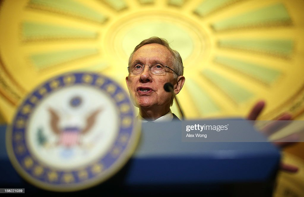 U.S. Senate Majority Leader Sen. <a gi-track='captionPersonalityLinkClicked' href=/galleries/search?phrase=Harry+Reid&family=editorial&specificpeople=203136 ng-click='$event.stopPropagation()'>Harry Reid</a> (D-NV) speaks to members of the media during a news briefing after the weekly Senate Democratic Policy Luncheon December 11, 2012 on Capitol Hill in Washington, DC. Reid discussed various topics with the media including the 'fiscal cliff' issue.