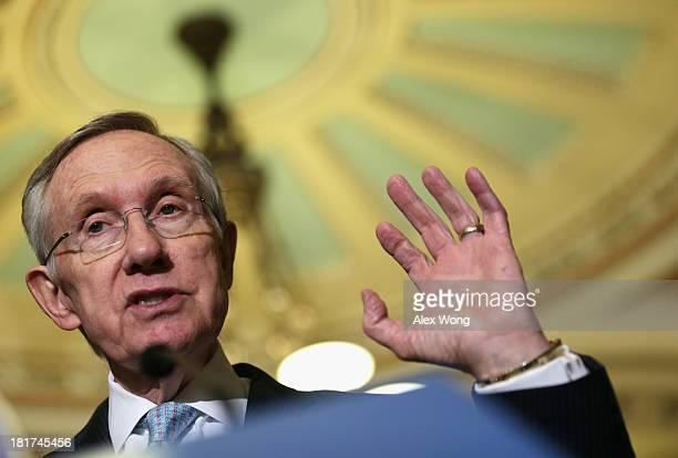S Senate Majority Leader Sen Harry Reid speaks to members of the media after the weekly Senate Democratic Policy Committee luncheon September 24 2013...