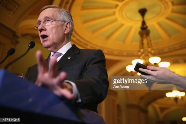 S Senate Majority Leader Sen Harry Reid speaks to members of the media after the weekly Senate Democratic Policy Committee luncheon December 17 2013...